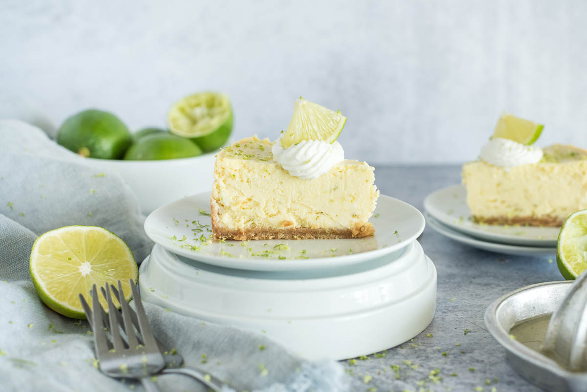 slice of instant pot key lime pie with cream and lime slices on top