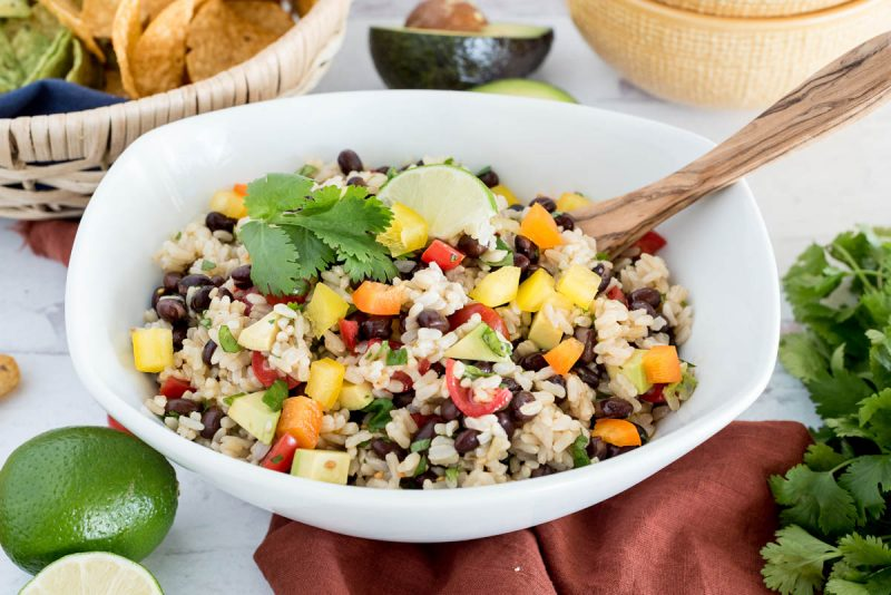 bowl of instant pot black bean and rice salad with limes
