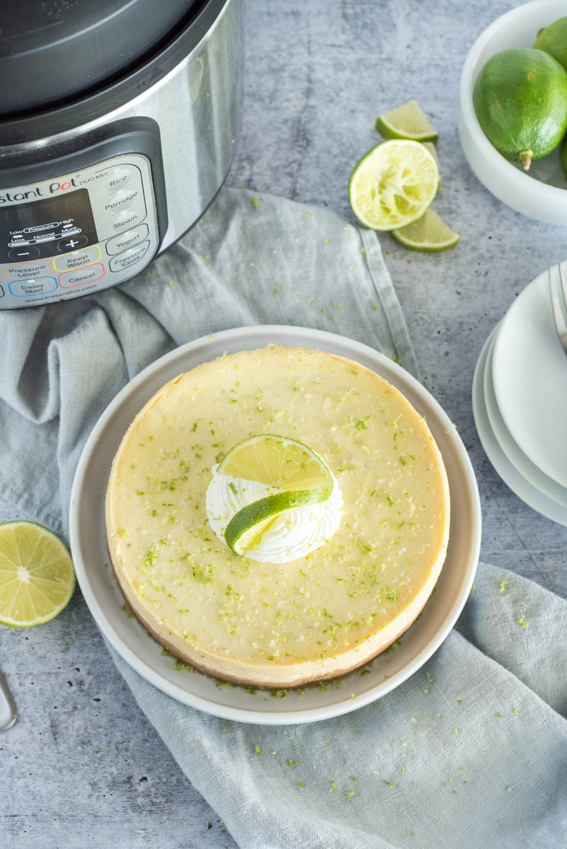 key lime pie in front of an instant pot pressure cooker