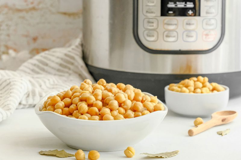 bowl of cooked chickpeas in front of an instant pot pressure cooker