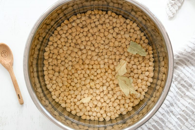 raw chickpeas and water in an instant pot