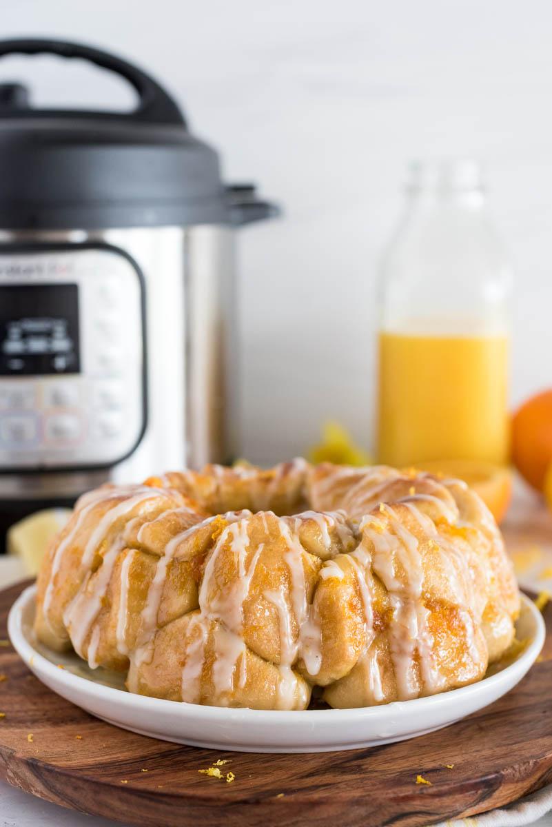 bundt pan ring of citrus monkey bread in front of an instant pot pressure cooker