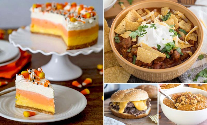 a collage of four recipes featured in the Halloween recipe roundup: on the left is a slice of candy corn cheesecake, colored in the classic candy corn colors, then on the top right is a yellow bowl of chili garnished with yellow tortilla chips and sour cream and cilantro, on the bottom middle is a steak and cheddar sandwich with lots of yellow cheese sauce dripping under the bun, and then the bottom right is a bowl full of Instant Pot pumpkin pie steel cut oats