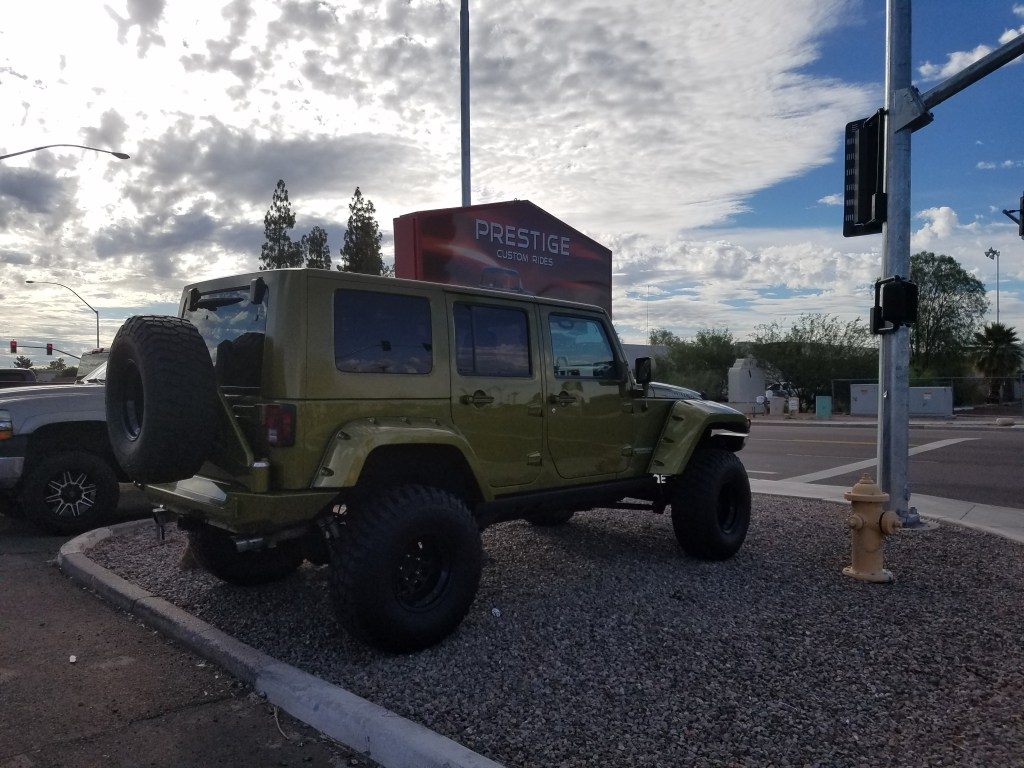 2008 JEEP JK UNL WITH A 4 SUSPENSION LIFT AND BUSHWACKER FENDER FLARES AND BFG MTS WITH EXPEDTION ONE FRT AND REAR BUMPER AND A WARN HP WINCH WITH COMPRESSOR