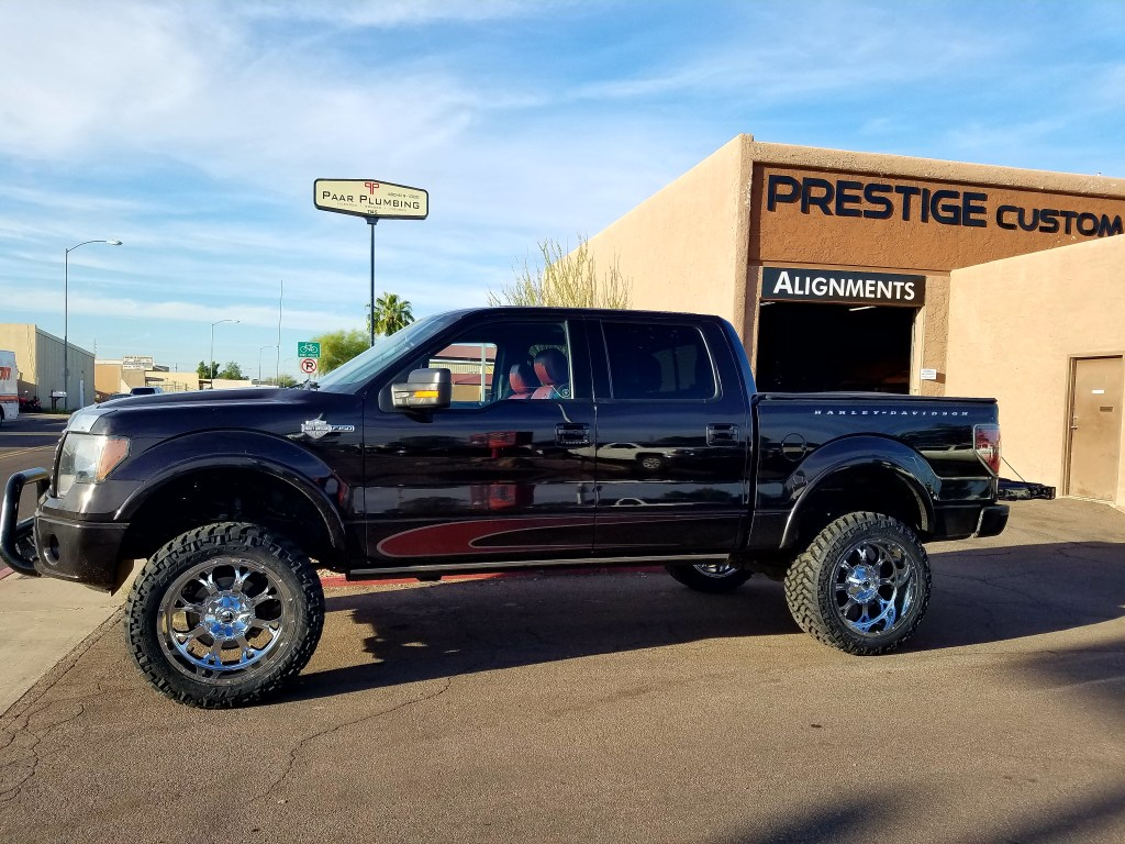 2010 FORD F150 4X4 WITH A 6 ROUGH COUNTRY SUSPENSION LIFT KIT AND A SET OF FUEL 22X10 CHROME WHEELS WITH NITTO TERRA GRAPPLER 325X60R20 (3)