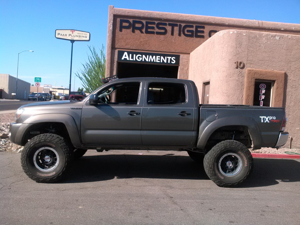 2011 TOYOTA TACOMA WITH 6 ROUGH COUNTRY LIFT KIT AND FACTORY WHEELS WITH GENERAL R LETTER 35 (1)