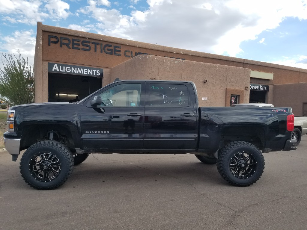 2014 CHEVY 1500 4X4 WITH A 7.5 ROUGH COUNTRY SUSPENSION LIFT KIT AND A SET OF K2 THOR 20X9 BLACK AND MILLED WHEELS WITH THE FIRESTONE DESTINATION MTS 35X12 (3)