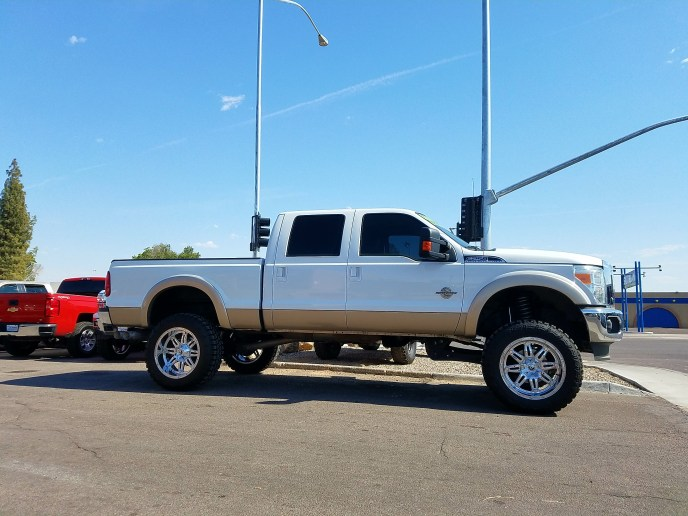 2014 FORD F250 4X4 WITH A 6 ROUGH COUNTRY SUSPENSION LIFT KTI AND A SET OF FUEL OFF ROAD WHEELS 22X12 WITH THUNDER MTS 37X13.50R22
