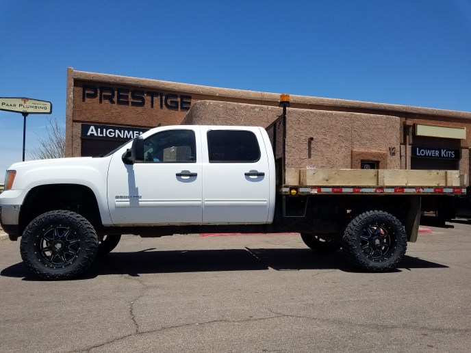 2014 GMC 3500 4X4 WITH A 7.5 ROUGH COUNTRY SUSPENSION LIFT KIT WITH MAYHEM MONSTIR 20X9 BLK AND MIL WITH TOYO MTS 35X12 (4)