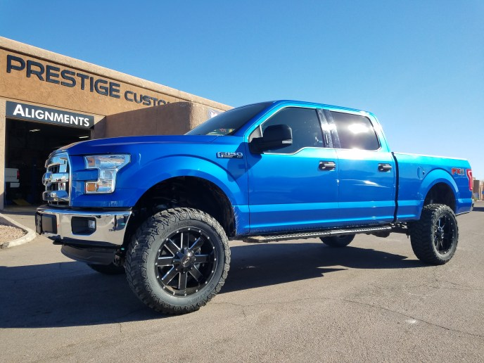 2016 FORD F150 4X4 ROUGH COUNTRY SUSPENSION LIFT KIT AND A SET OF MAYHEM WHEELS AND 35X12.50R20
