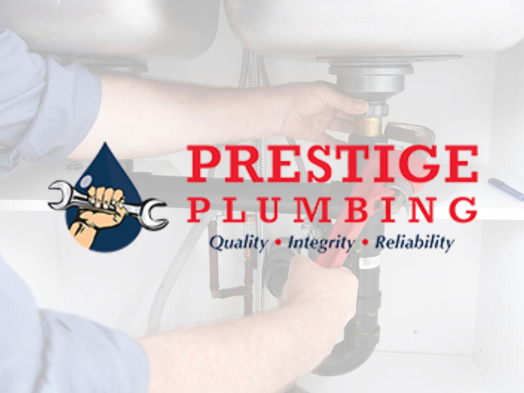 Plumber installing pipes