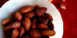 bowl of red-tinted, spicy almonds
