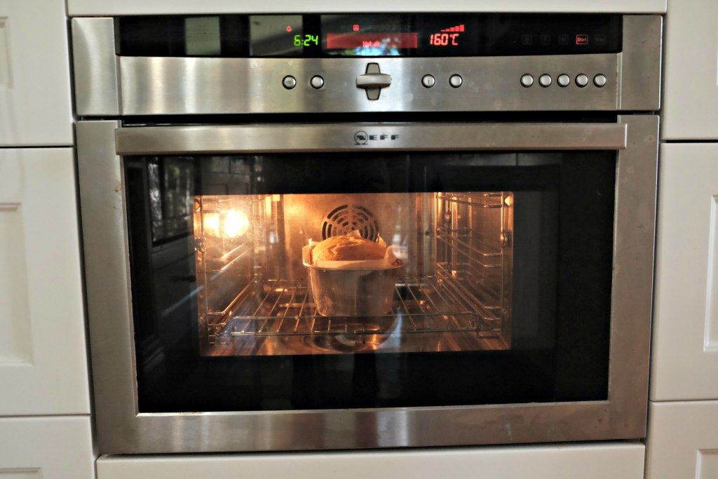 Picture of banana bread in the oven booking.