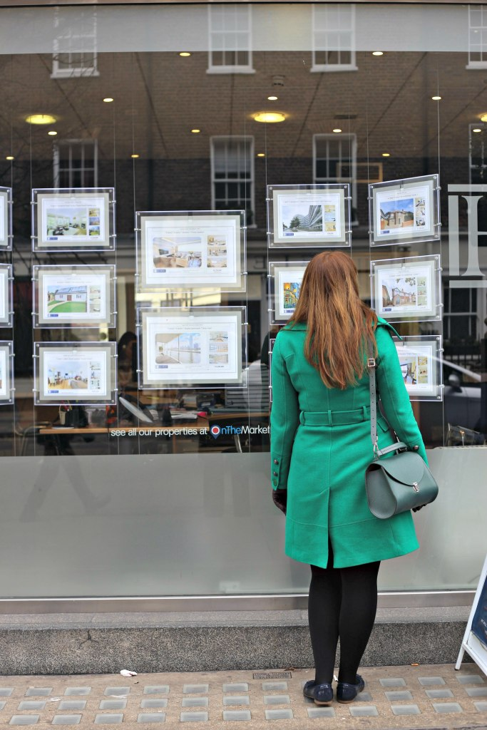 Picture of me in front of real estate agents looking at property.  Buying A Flat In London - Part 2.