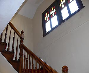 Stairway with stained glass windows at Schenectady apartment house