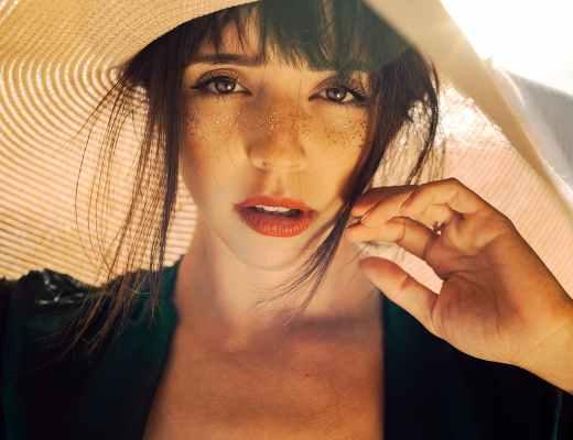 photo of woman wearing sun hat