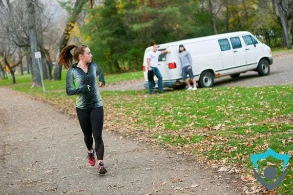 woman_running_by_two_men_leaning_on_a_van_staring_at_her