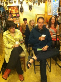 Contributors and friends gather for a reading at Biddle's Escape in Pittsburgh, PA.