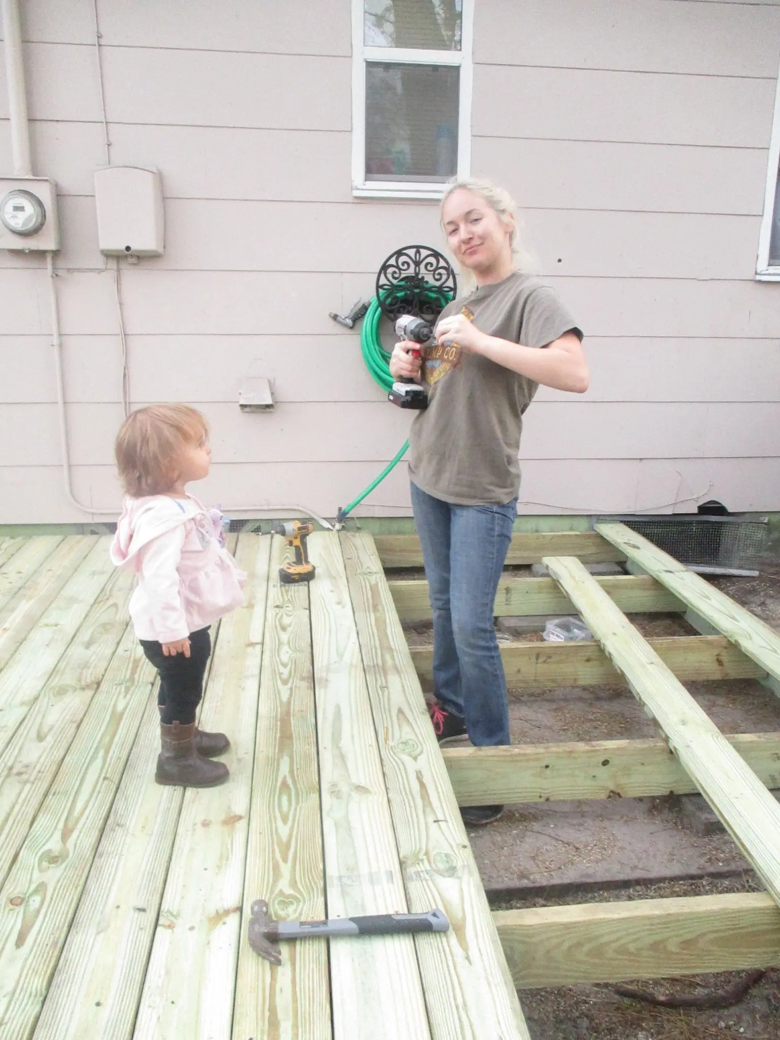 drilling the deck boards into place
