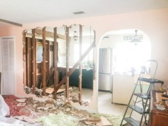 DIY load bearing wall removal: step one - stripping it to the studs