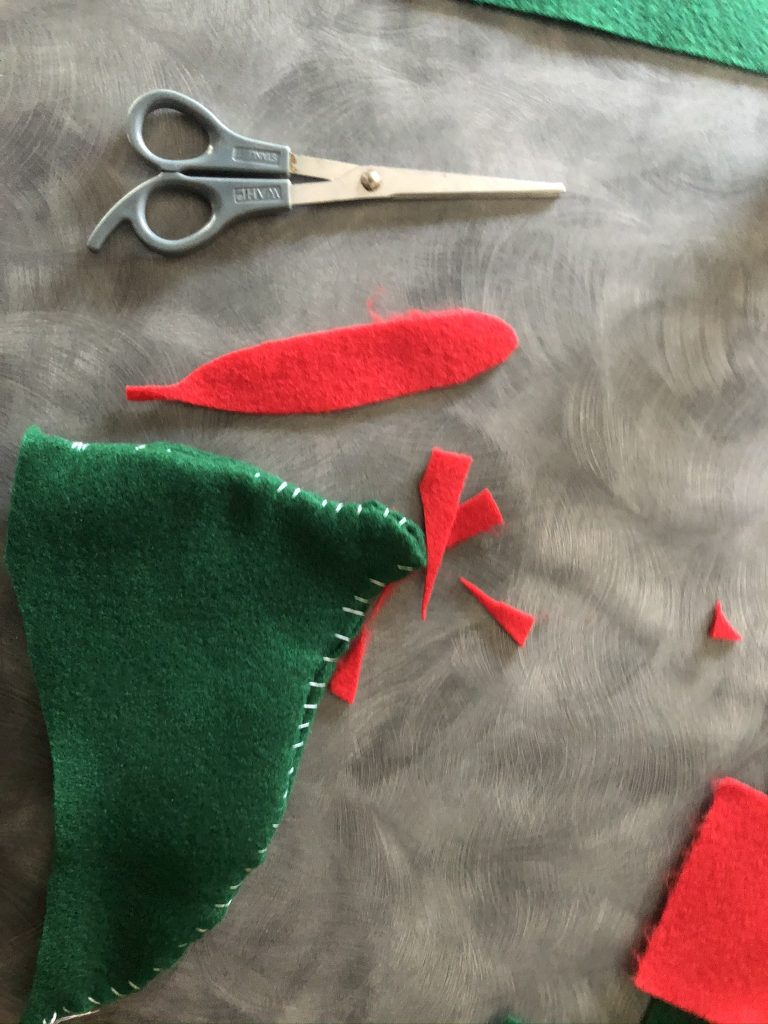 DIY felt peter pan hat with red felt feather