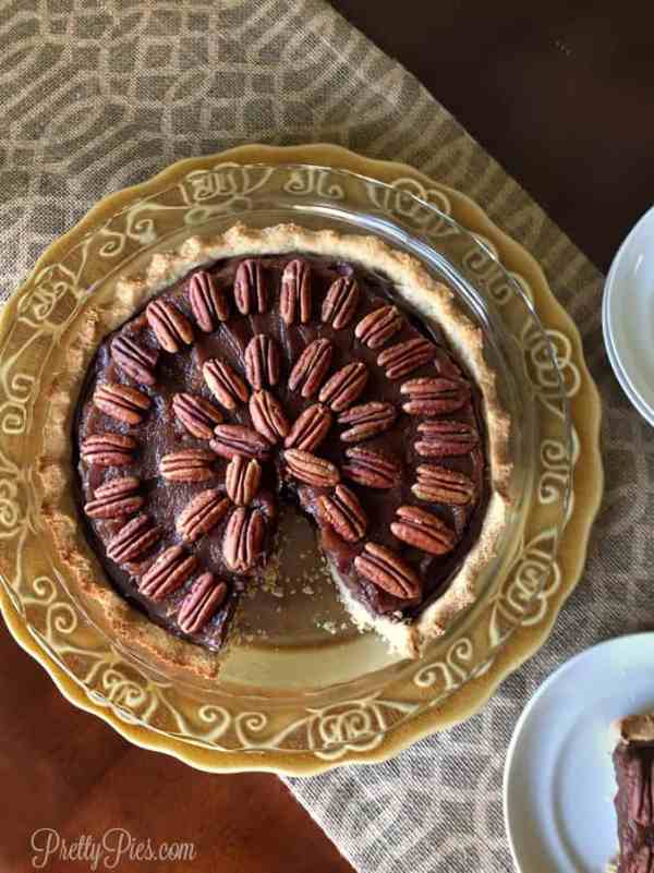 Rich, creamy chocolate topped with sweet caramel and toasted pecans on a buttery crisp crust. But made healthier using whole foods!