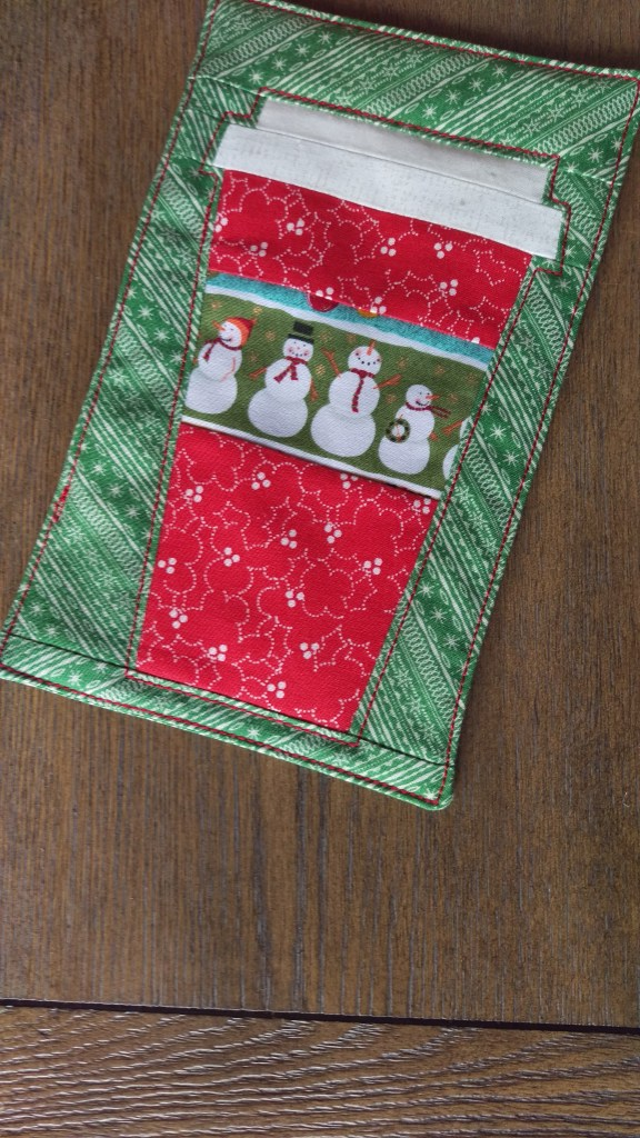 That Red Cup paper pieced mug rug in Christmas fabrics