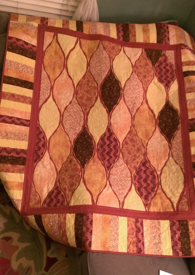 flying carpet quilt in browns