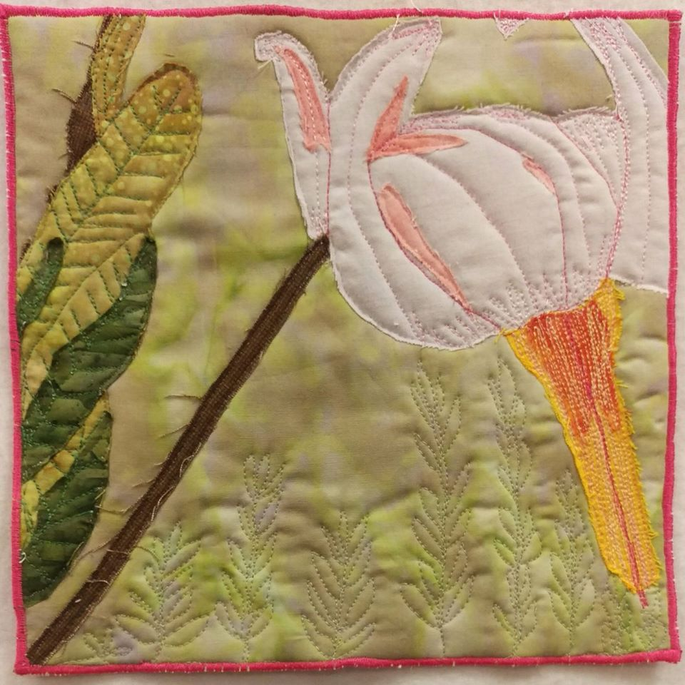 mini art quilt made from a photo of a cranberry blossom