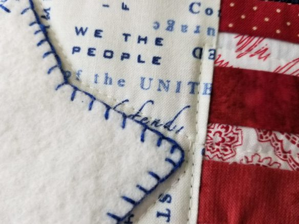 detail of flag mug rug