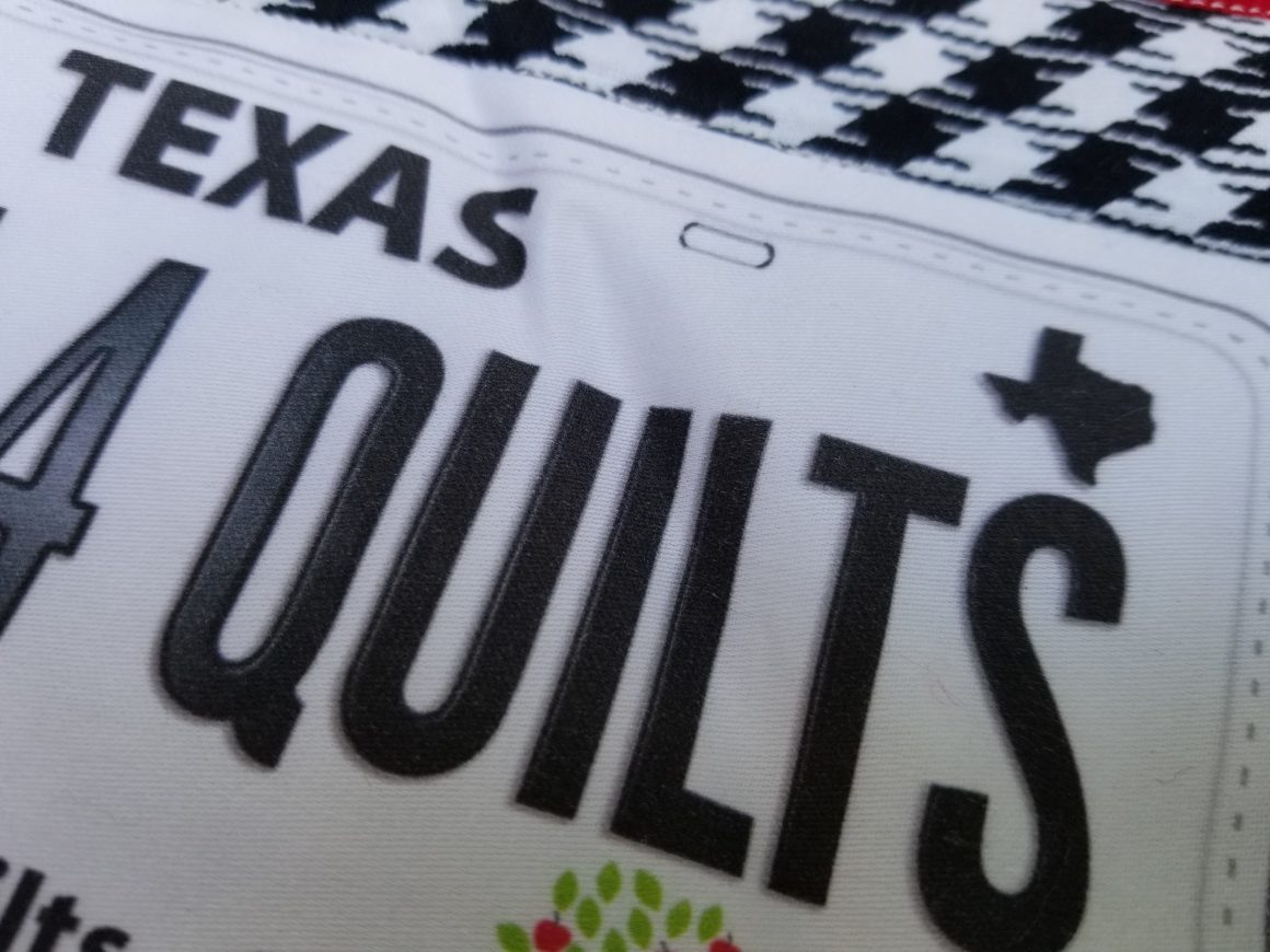 close up of Texas row by row license plate mug rug