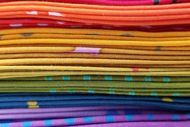 stack of rainbow Alison Glass Chroma fabrics