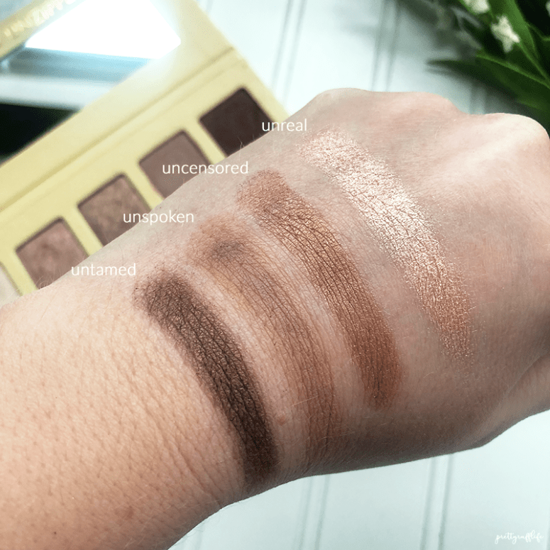 finger swatches of the Lorac Unzipped palette in the shades unreal, uncensored, unspoken and untamed