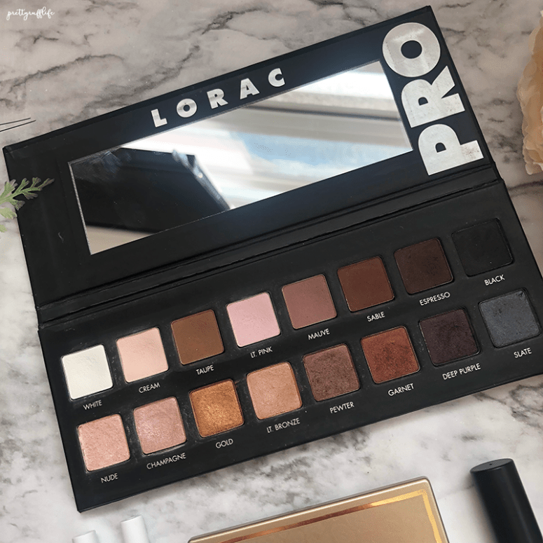 Lorac Pro Eyeshadow palette open-faced and sitting on a marble background