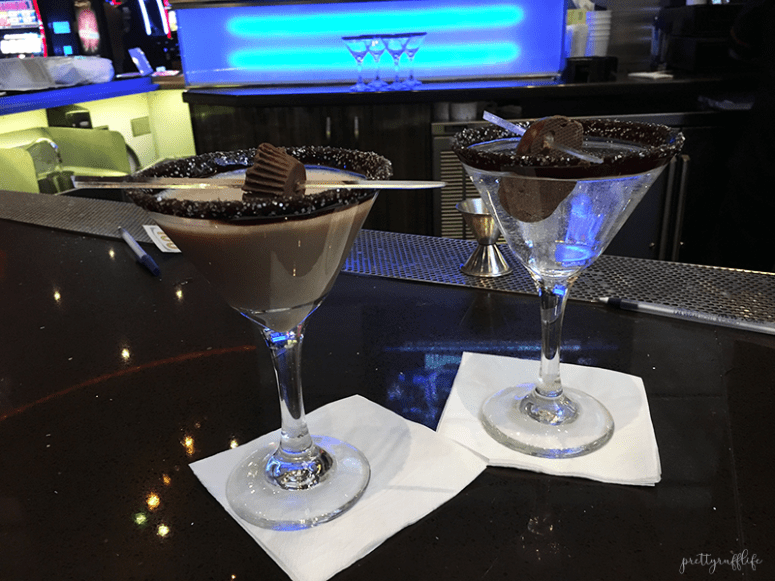 Two martinis with chocolate garnishes sitting on white napkins on a black counter at the Chocolate Bar at the NY NY hotel in Las Vegas