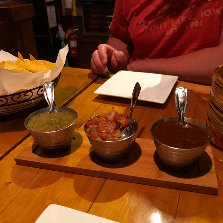 A picture of three small silver bowls of salsa (green, pico de gallo and red) from Casa 43 Mexican Kitchen & Tequila Bar in Grand Cayman Islands