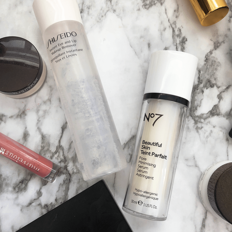 A close up of the No.7 Beautiful Skin Serum and Shiseido Makeup Remover on a marble background