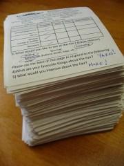 stack of paper surveys