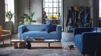 IKEA makes a new dress for KLIPPAN sofa with MUD Jeans by using recycled jeans