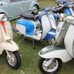 A Collection Of Retro Scooters With An Old Retro Car In The Background Stock Photo Picture And Royalty Free Image Image 17393098