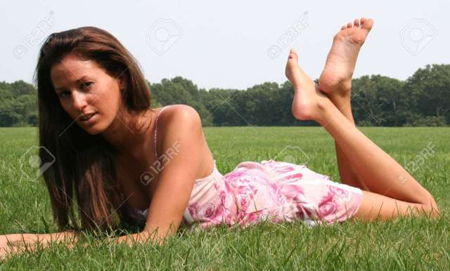 Barefoot Girl Relaxing In The Grass Stock Photo 3384298