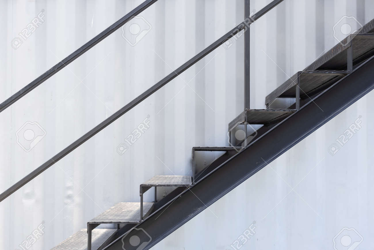 Side View Of Outside Metal Staircase Or Fire Exit Stair With | Outside Metal Stair Railing | Steel | Concrete | Steel Handrail | Porch | Outdoor Stair
