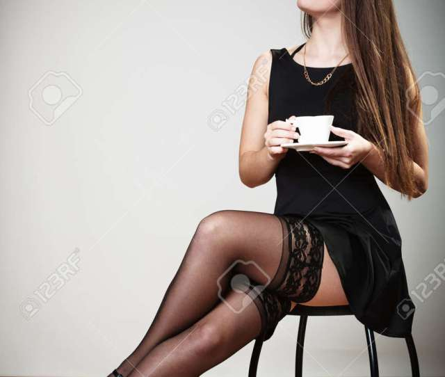 Full Length Beautiful Sexy Young Girl In Stockings Holding Cup Of Coffee Drinking Stock Photo