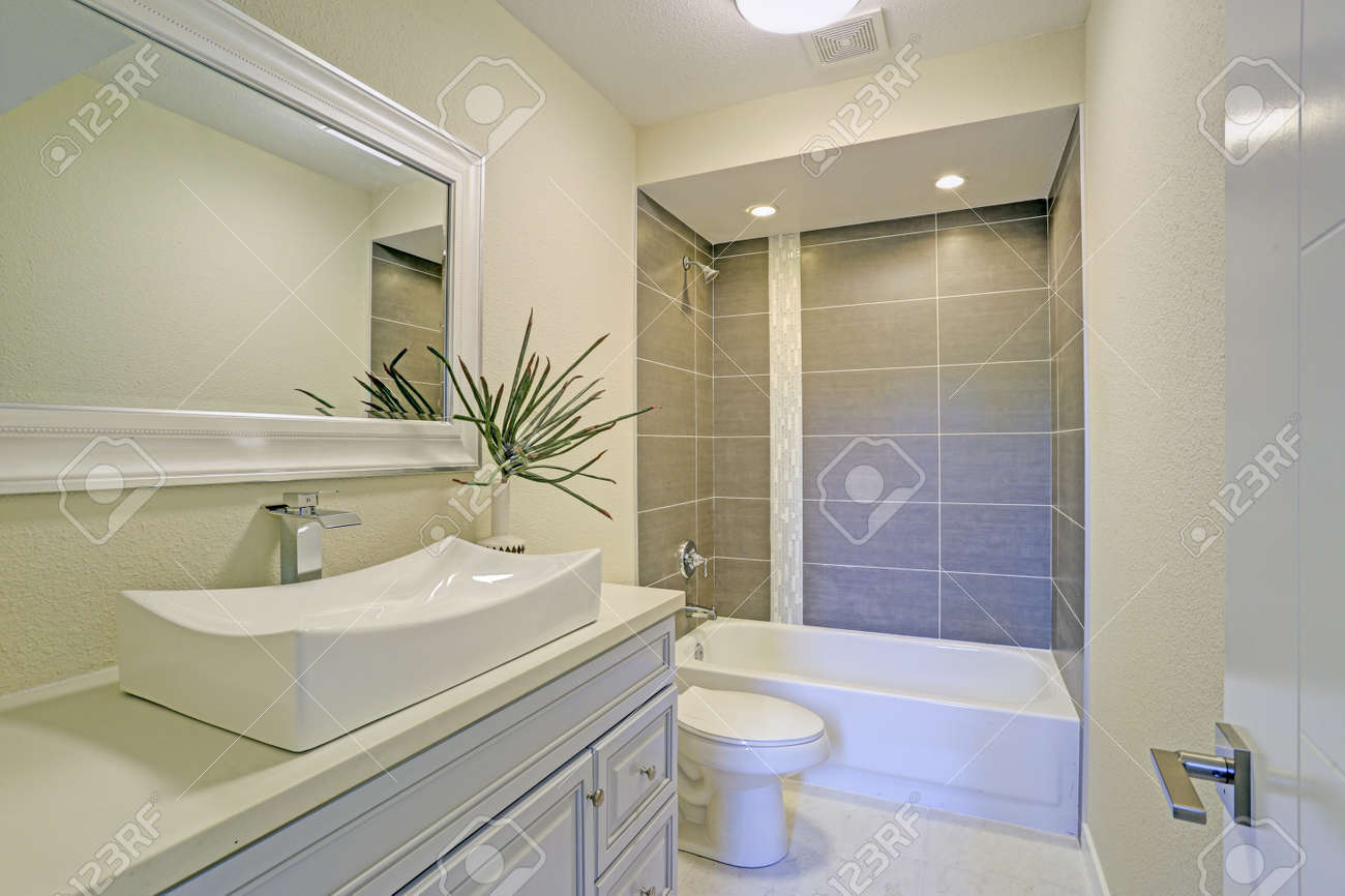 freshly renovated bathroom features shower tub combo with grey