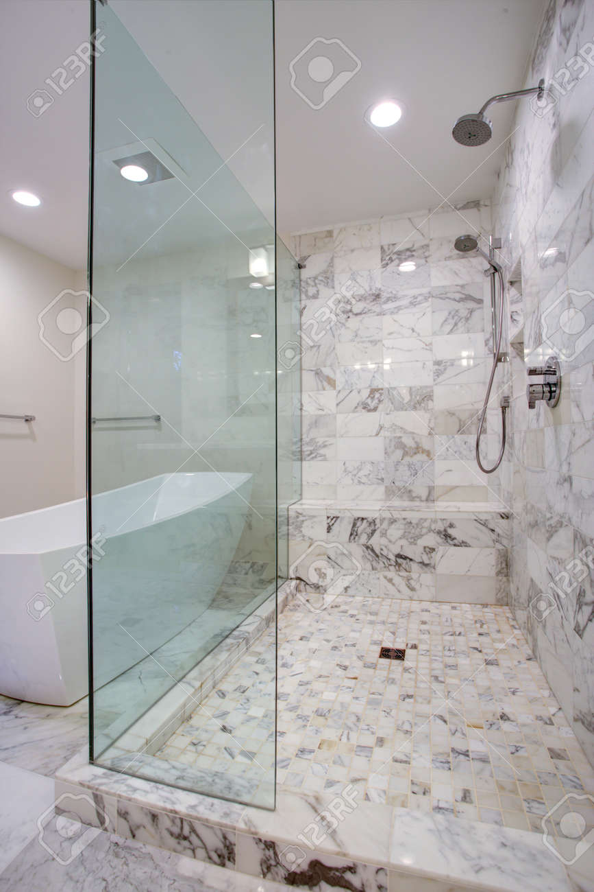 Sleek Bathroom Features Large Walk In Frameless Glass Shower