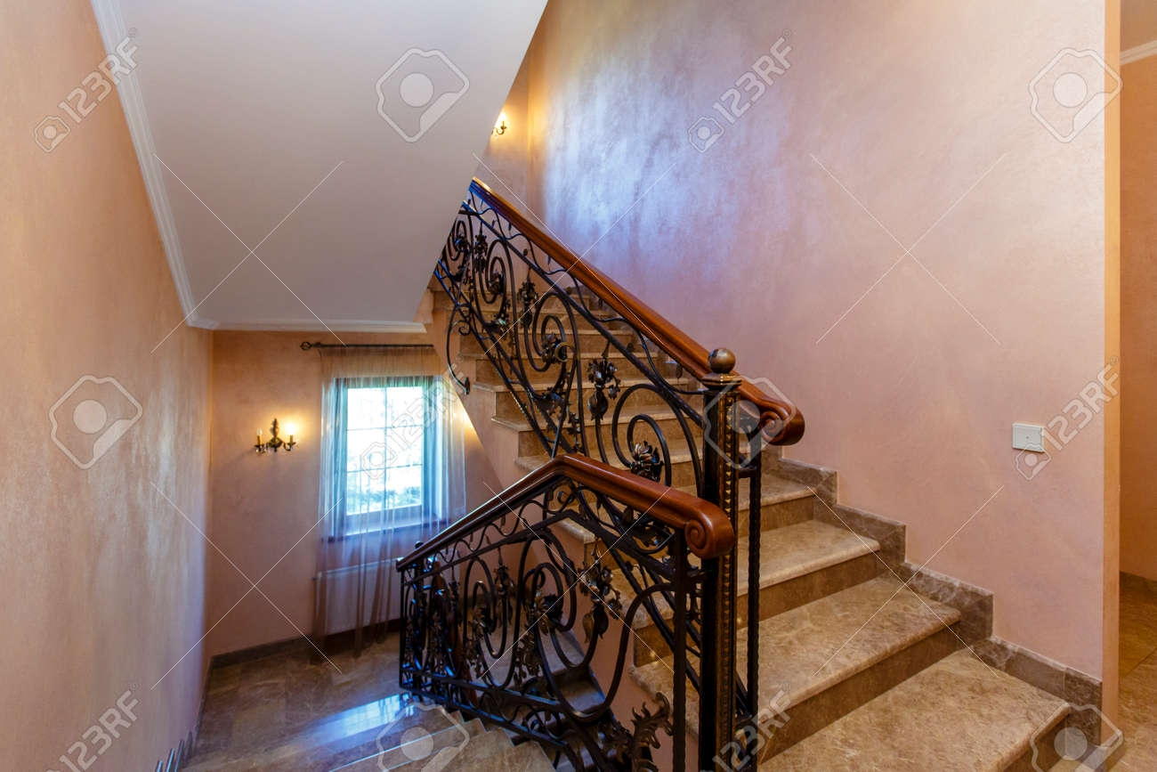 A Rich And Beautiful Staircase With Wrought Iron Railings And   Metal Railing With Wood Handrail   Cable Railing   Wrought Iron Balusters   Stainless Steel Railing   Deck Railing   Carpeted Stairs