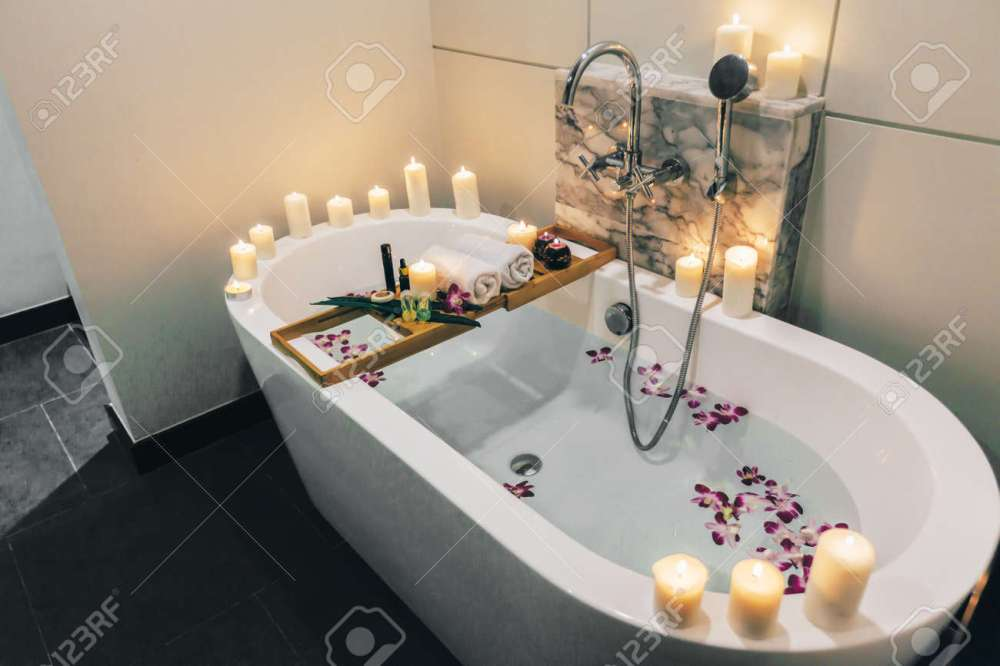 Prepared Luxury Spa Bath Decorated With Flowers And Candles ...