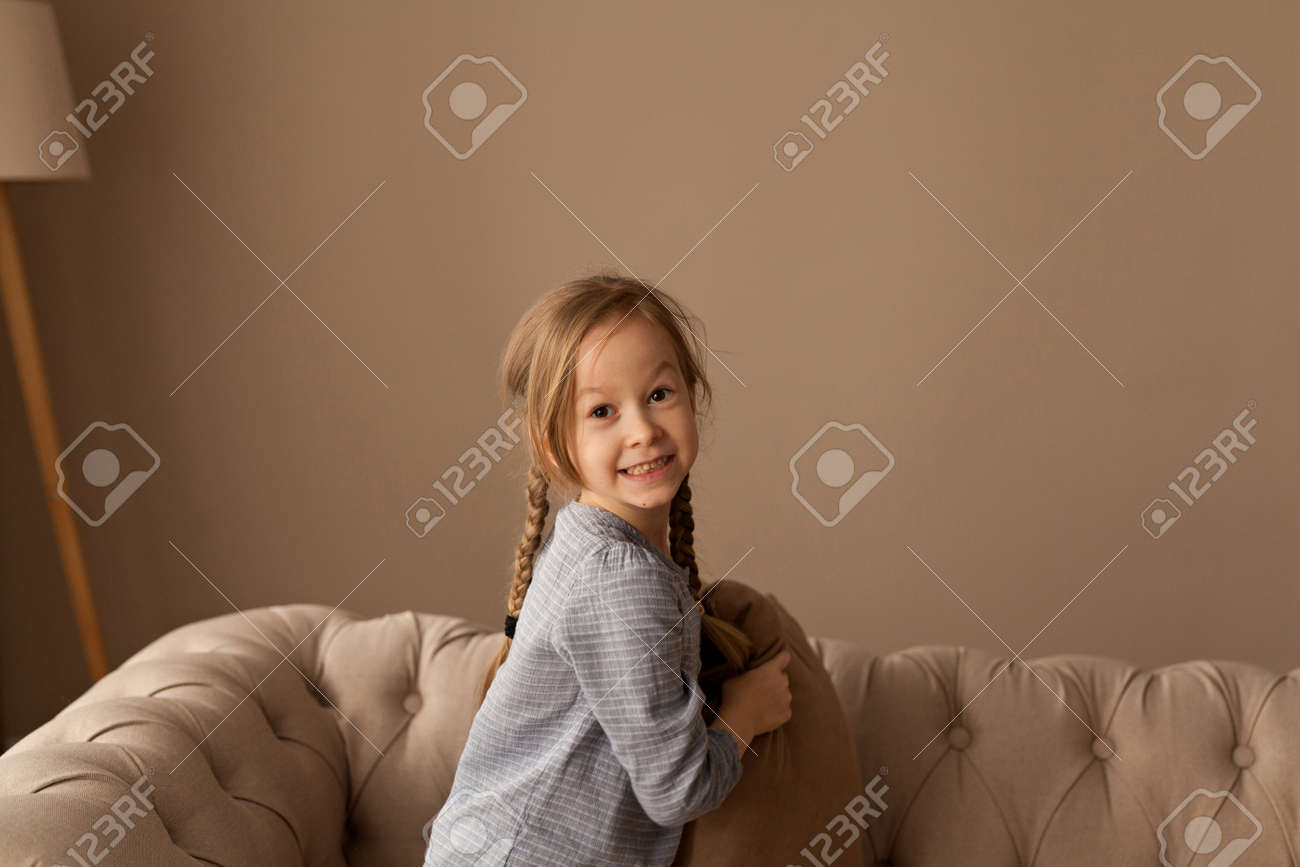 seven year old girl plays pillow fight stock photo picture and royalty free image image 127281010