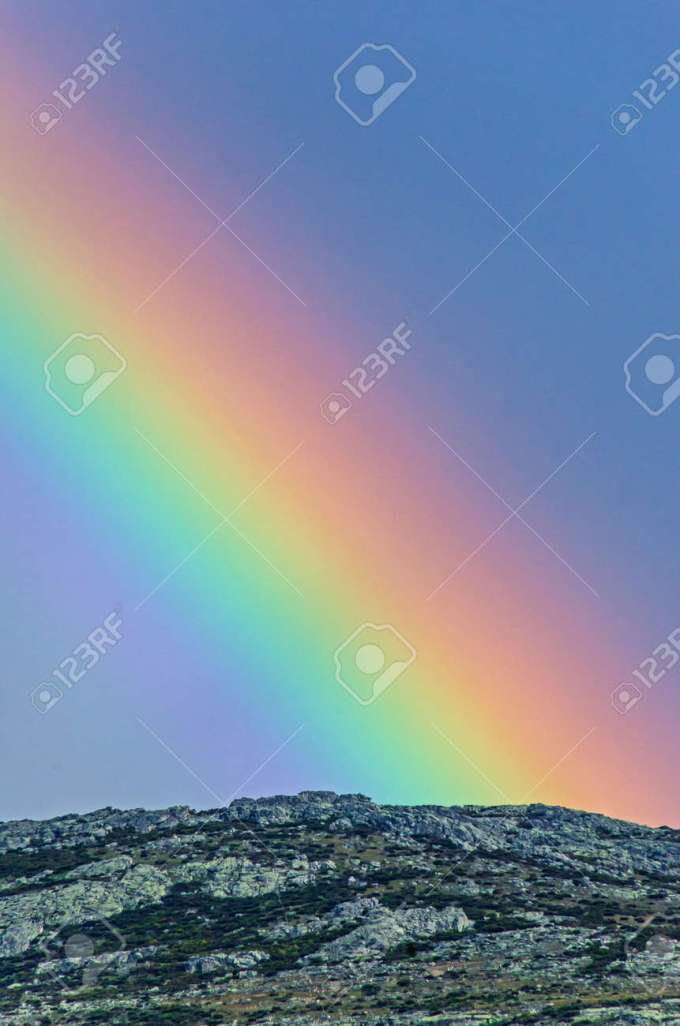 Real Rainbow Over The Mountains After Storm Arco Iris Or Arcoiris Is The Traslation Of Rainbow In Spanish Stock Photo Picture And Royalty Free Image Image 102794801