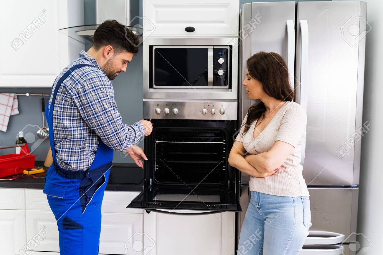 oven appliance repair and maintenance by technician stock photo picture and royalty free image image 152982887